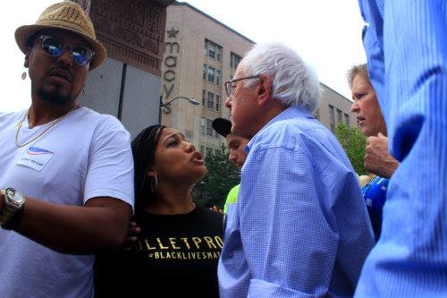 """As I stood just a few feet away from Bernie and Jane I heard him tell the protesters """"If you want to talk, let's talk but I'm not going to shout over you"""" and then yielded the microphone."""