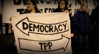 "As the Trans-Pacific Partnership trade pact was signed by the United States and 11 other countries, Bernie Sanders promised to ""fundamentally rewrite our trade policies to benefit working families, […]"