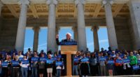 "He challenged Hilary Clinton to support his legislation for a tax on planet-warming carbon dioxide emissions. ""Join me and impose a tax on carbon,"" Sanders said of legislation he has introduced in the Senate."